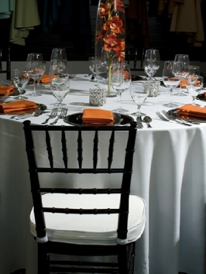 Black Chiavari Chair, White Cotton Linen, Orange Cotton Napkins, Silver Chargers